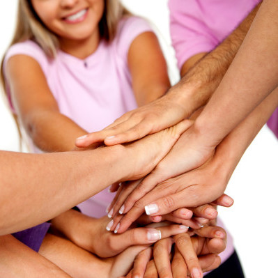 Group of people with their hands together in the middle isolated - teamwork concepts